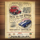 The cover shows an old-west style poster featuring two classic cars.
