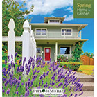 The cover shows a walkway up to a two-story gray house, bordered by lavender and a picket fence.