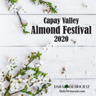 This magazine cover shows a white-painted wood wall with almond blossom branches coming from the bottom and top of the frame.